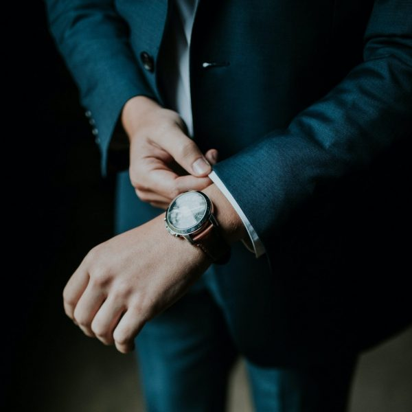 A man checks his watch